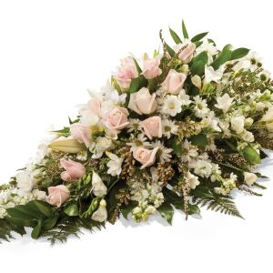 A seasonal selection of Roses, Stocks, Spray Chrysanthemums, Freesias, Lilies, Seasonal flowers, foliages and fillers